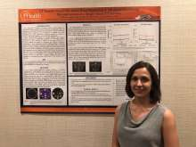 Catherine Olguin, Medical Physics PhD Student, in front of FLAAPM poster